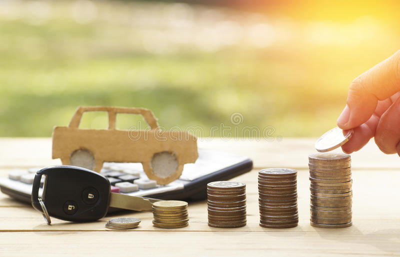 Row of money cooins and hand on wood. Background, concept in finance, account, buying and selling car and capital banking royalty free stock photo