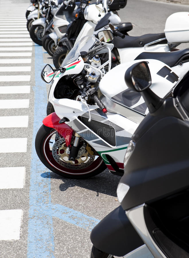 Row of motorbikes. One Row of parked motorbikes royalty free stock photos