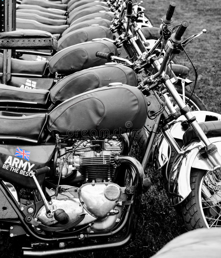 Row of Motorcycles. Motorcycles lineup: a row of motorcycles lineup at a The Royal Signals White Helmets stunt motorcycle display team. White Helmets are a royalty free stock image
