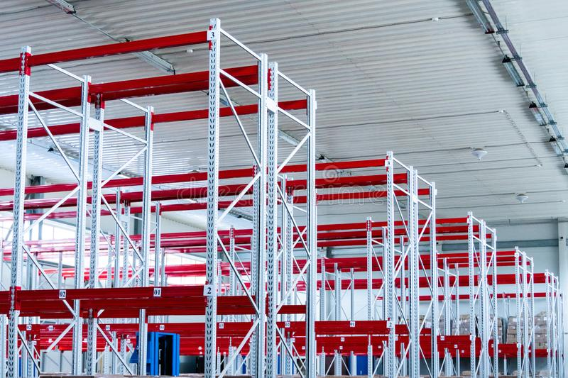 Row of mpty warehouse racks, Empty metal shelf in storage room royalty free stock photo