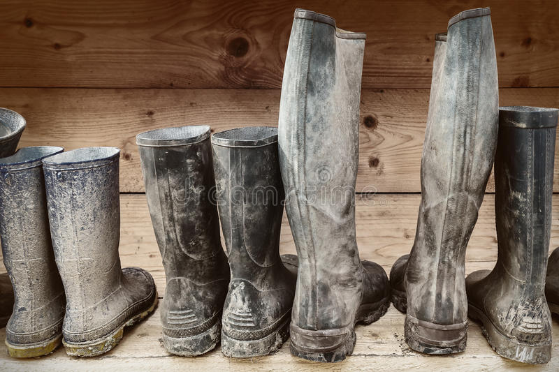 Row of muddy boots stock photography