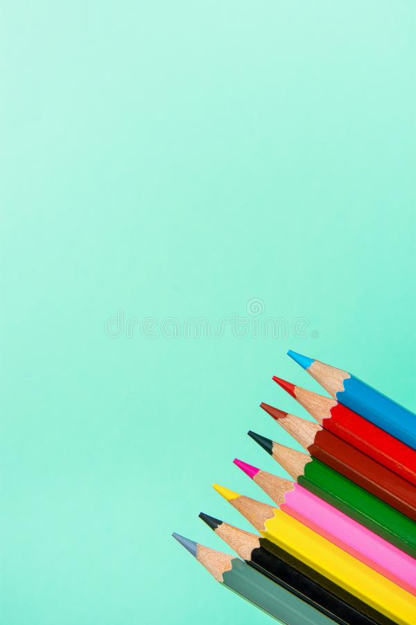 Row of Multicolored Pencils on Turquoise Background. Business Creativity Graphic Design Crafts Kids School Drawing Blogging stock photos
