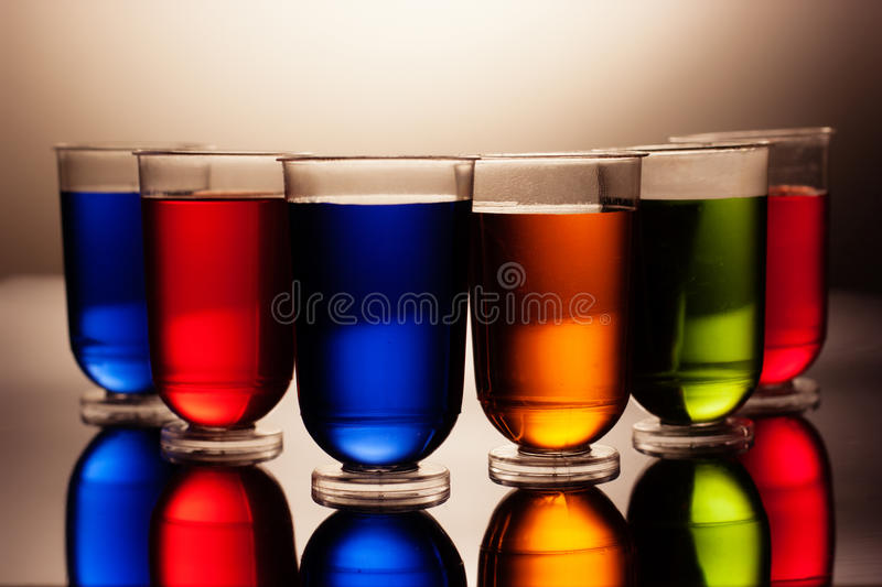 Row of multicoloured alcohol drinks. In shot glasses royalty free stock photography