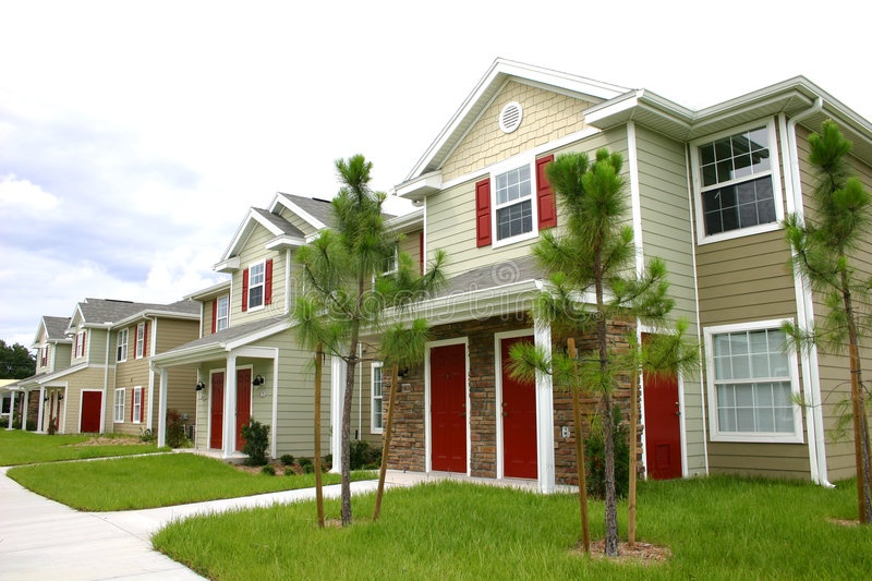 Row of new condos. Row of attractive newly constructed condos in Florida, with red shutters and doors and gabled roofs