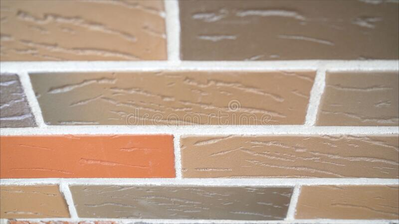 Row of new detached houses. Brickwork of the facade of the house made of colored brick. Colored brick house. Brickwork of the facade of the house made of colored stock image