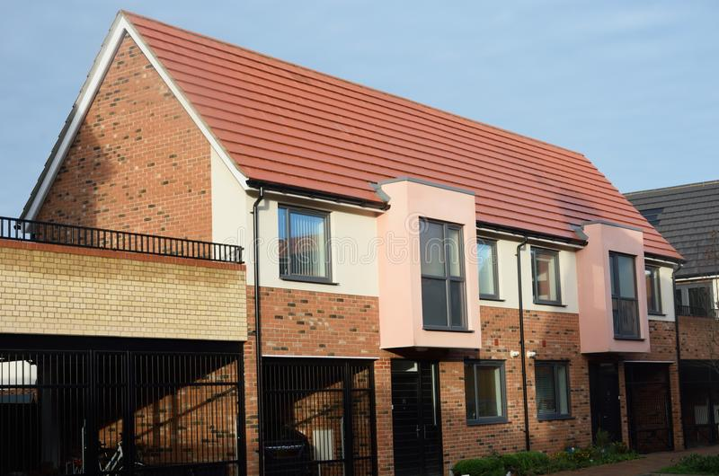 Row of new english terrace houses. Row of new english brick terrace houses royalty free stock photography