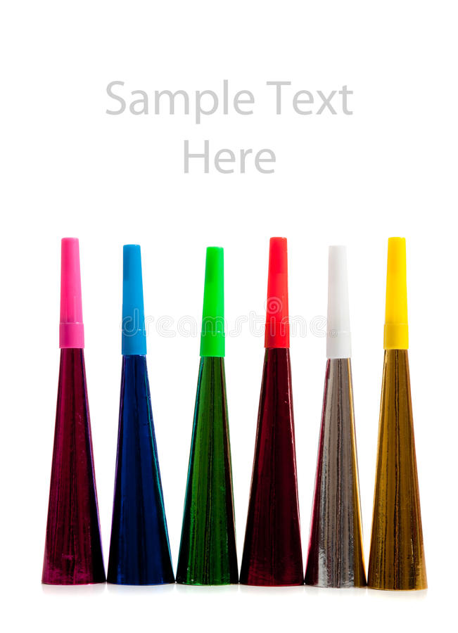 Row of noise makers on white with copy space royalty free stock photo