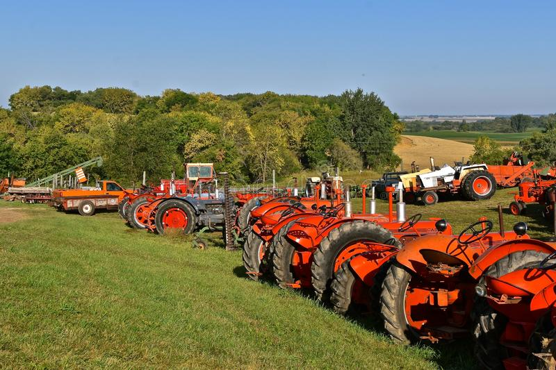 Row of old Case tractors at a farm show. ROLLAG, MINNESOTA, September 1, 2018: A row of old Case tractors are on display at the annual WCSTR farm threshers stock photo