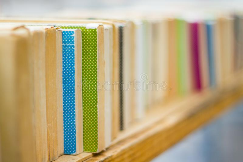 Row of old books on a shelf in a book store royalty free stock image