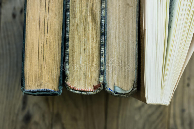Download Row Of Old And New Books, Top View Of Spine, Weathered Wood Background, Education, School, Learning Concept Stock Photo - Image: 95840812