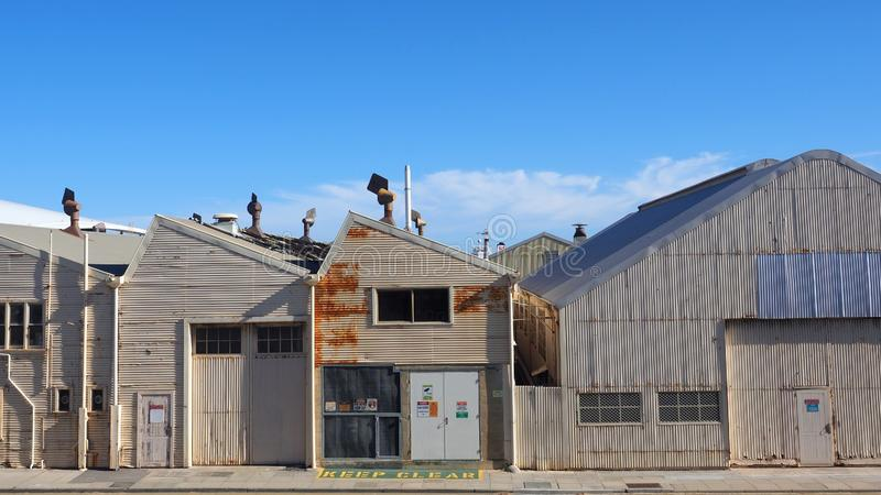 Old Corrugated Iron Warehouses,  Fremantle,  Western Australia. A row of old rusted corrugated iron warehouses behind the docks area precinct in Fremantle royalty free stock photography