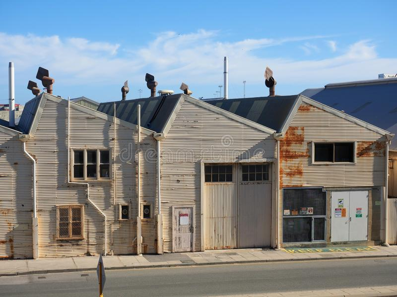 Old Corrugated Iron Warehouses,  Fremantle,  Western Australia. A row of old rusted corrugated iron warehouses behind the docks area precinct in Fremantle royalty free stock images