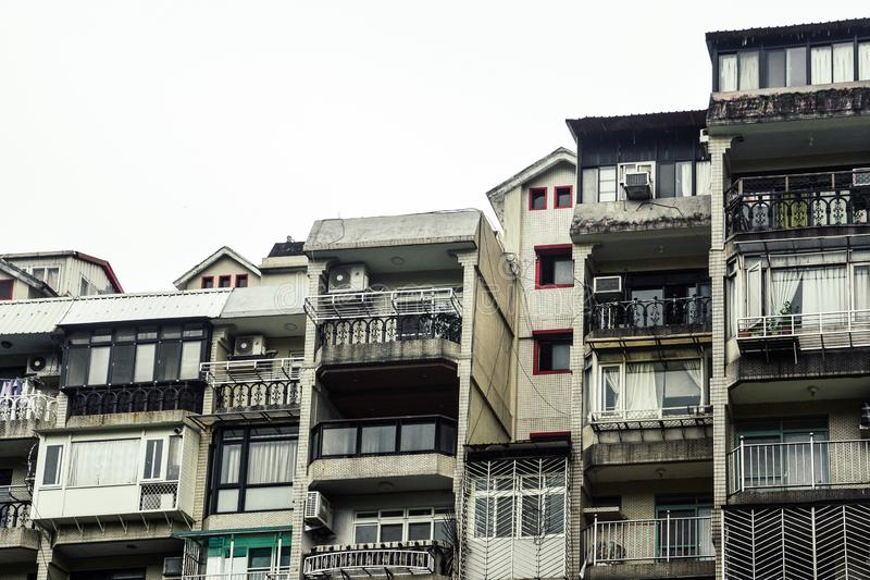 A row of old townhouse, old crowded vintage residential tenement house building in Taipei, Taiwan stock photo