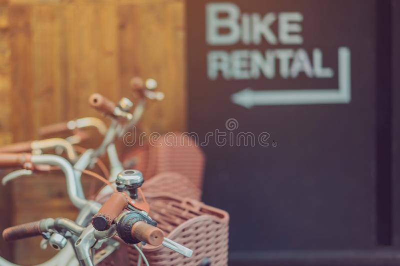 Row of parked vintage bicycles bikes for rent in front of the resort. royalty free stock images