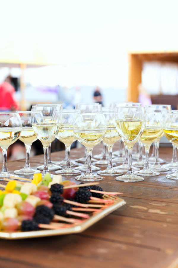 Row of party champagne glasses stock images
