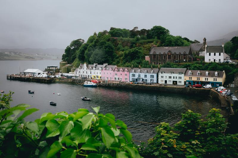 The row of pastel coloured houses in Portree harbour in gloomy w stock photography