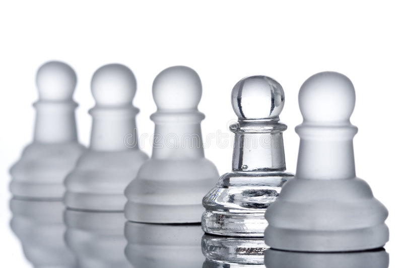 A row of pawns. With a clipping path royalty free stock photos