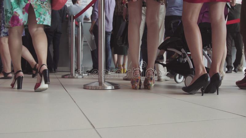 Row of people waiting in an airport. Feet of people in line at the airport royalty free stock photo