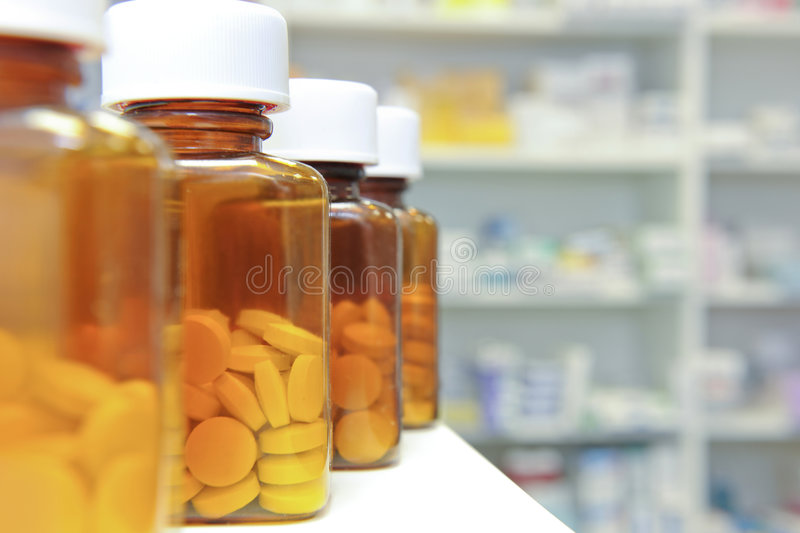 Row of pill bottles royalty free stock images