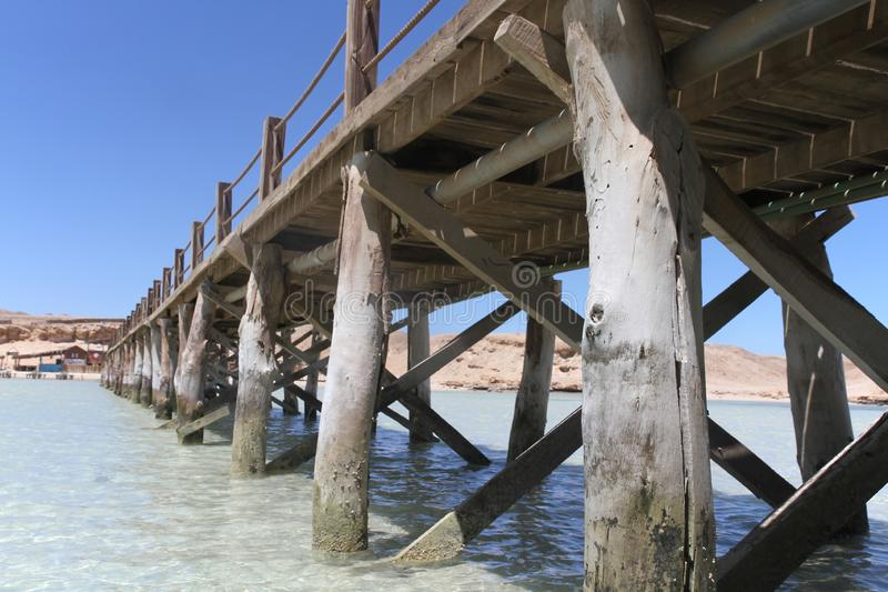 Row of pillars on the dock on Paradise island, Egypt stock photo