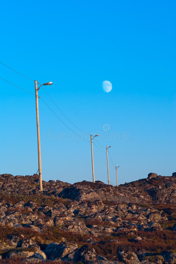 The row of pillars power line stock image
