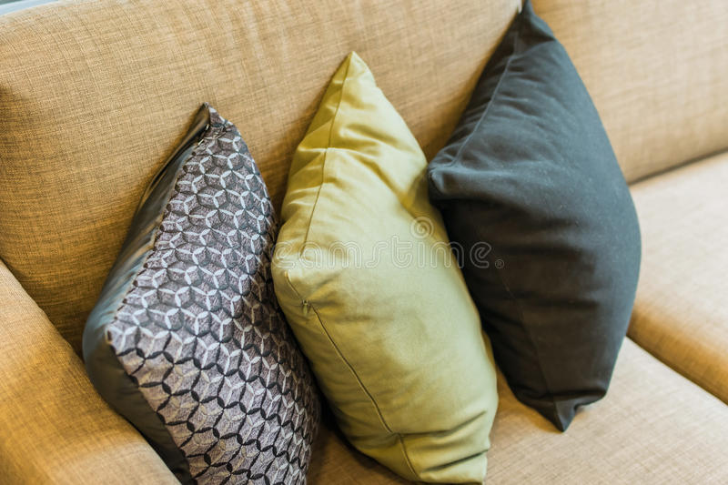 Row of pillows on sofa stock images