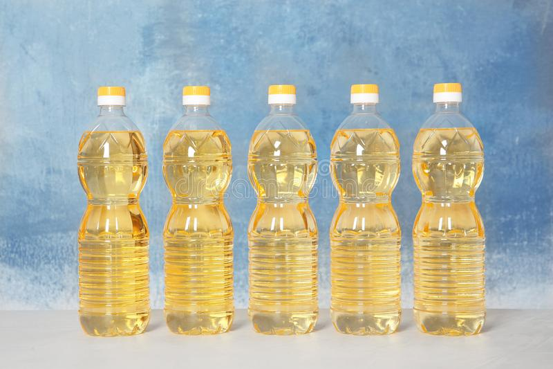 Row of plastic bottles with oil royalty free stock photos