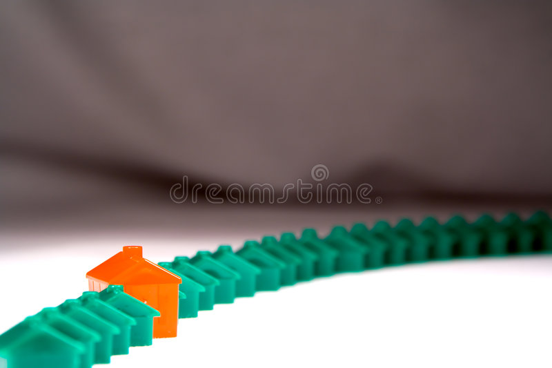 Download Row Of Plastic Houses Against A Backdrop Stock Photo - Image: 197806