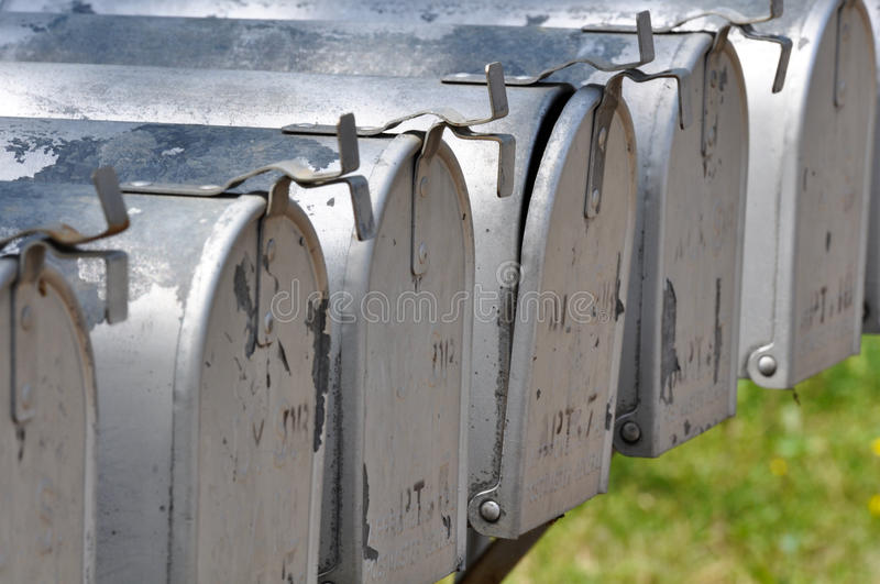 Row of Postal Mailboxes royalty free stock photos
