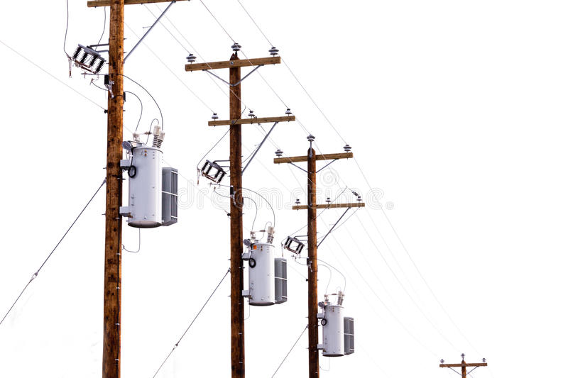Electrical Power Poles : Row of power pole transformers isolated on white stock