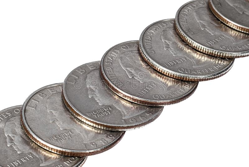 A row of quarter dollar coins on white background stock images
