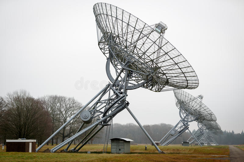 A row of radio telescope dishes stock photos