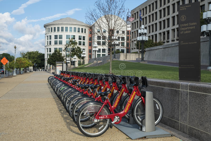 Row of Red Bicycles Used in the Capital Bikeshare Program Resting on the sidewalk #2 royalty free stock images