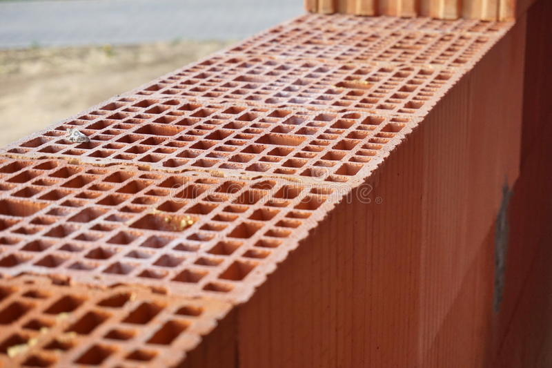 Download Row Of Red Bricks With The Holes In Shape Honeycomb On Construction