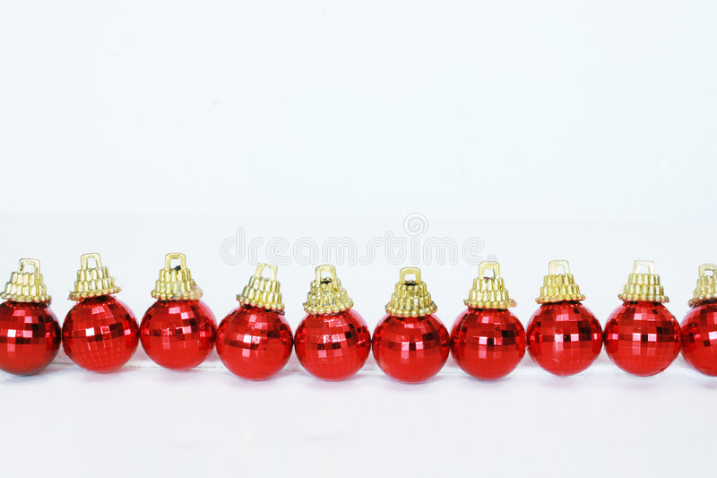 Row of red christmas balls stock images