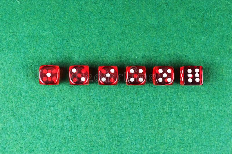 A row of red dices from one to six stock images