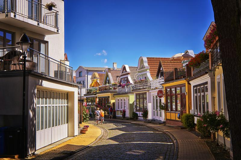 Row of residential houses in the traditional German architecture style. View of a street with colorful buildings. Warnemünde royalty free stock photography