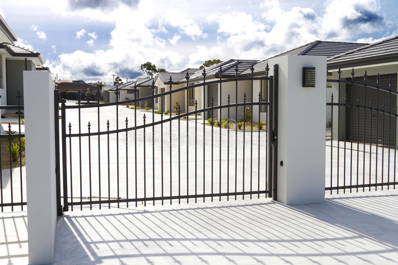 Row of residential units. Stunning modern stucco residential units behind security gates stock photo