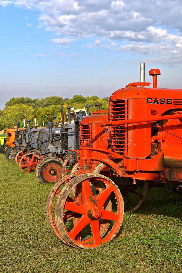 Row of restored Case tractors. ROLLAG, MINNESOTA, Sept 2, 2017: The fronts of a row of old Case tractors are displayed at the annual WCSTR farm show in Rollag stock image