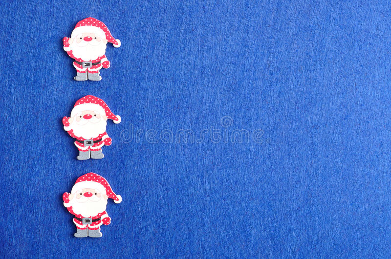 Row of Santa clauses. On a blue background stock photos
