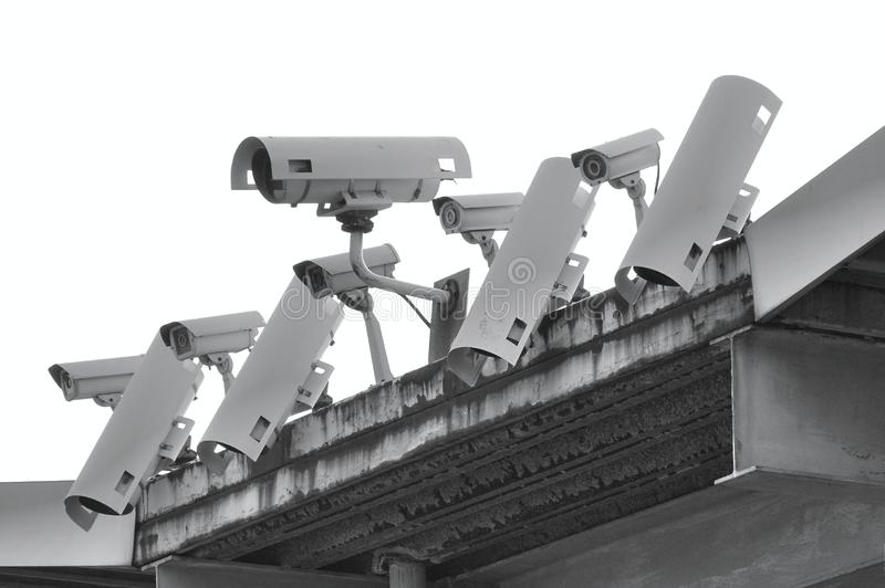 A Row of Security Cameras. A row of security and surveillance cameras royalty free stock photography