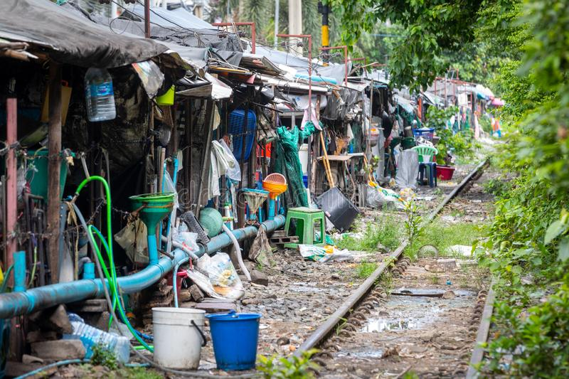 Row of shacks with small businesses beside the tracks of a train in central Bangkok in Thailand. royalty free stock photo