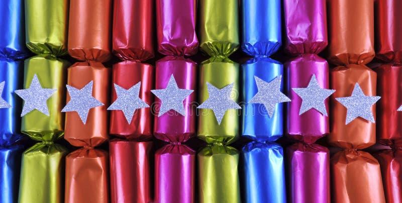 Row of shiny festive Christmas cracker bon bons stock images