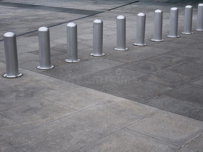 Short Metal Poles as Fence for Shopping Trolleys royalty free stock image