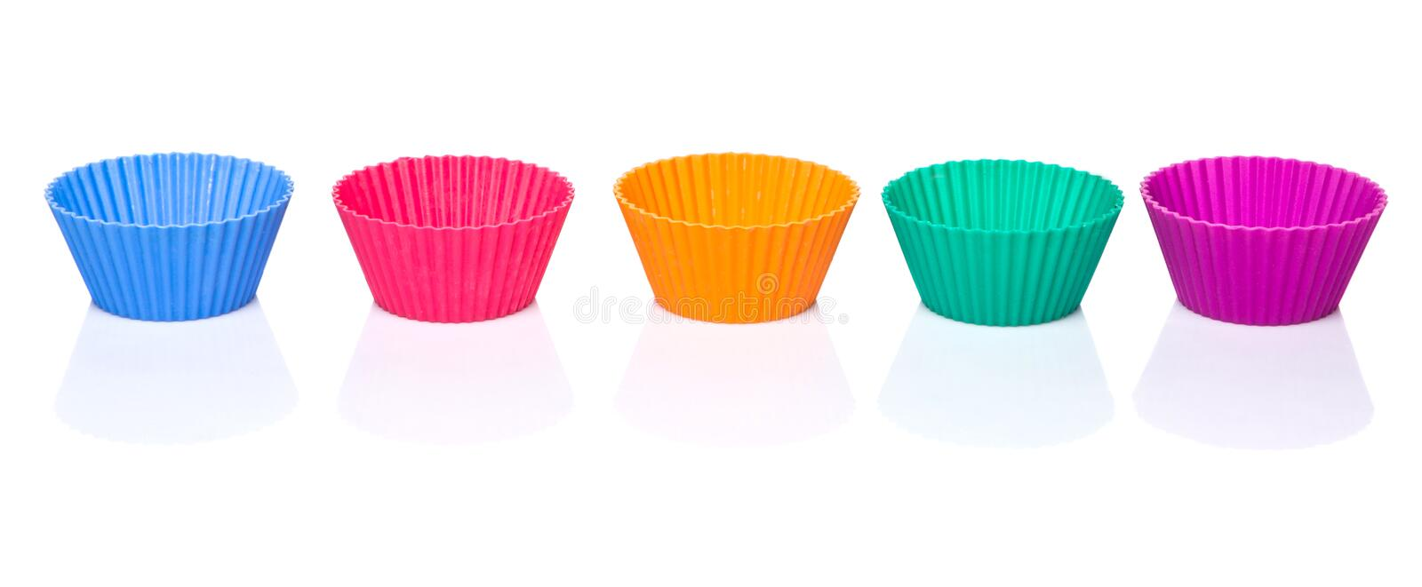 Row OF Silicone Cupcake Baking Cups III. Various colors of silicone cupcake silicone baking cups over white background stock photography
