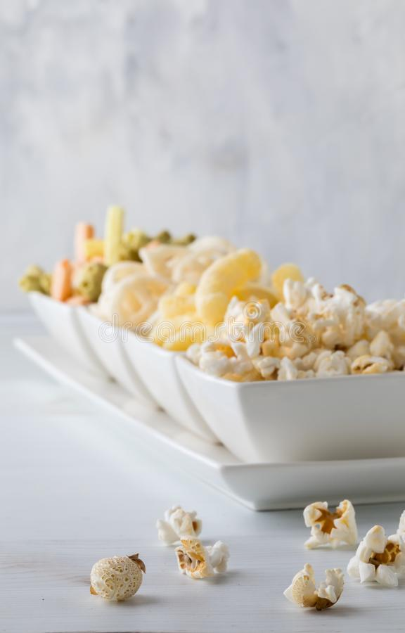 A row of small bowls of snacks. stock photos