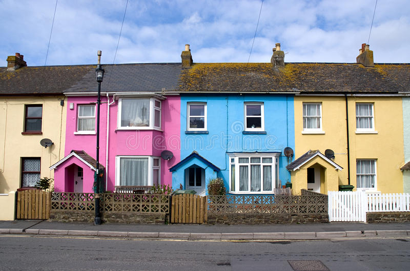 Row of small houses. Different colored houses in a row stock photography