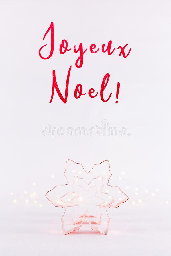 Row of Snowflake Copper cookie cutters on white sparkling background with bokeh lights. Holiday Christmas and New Year card stock image