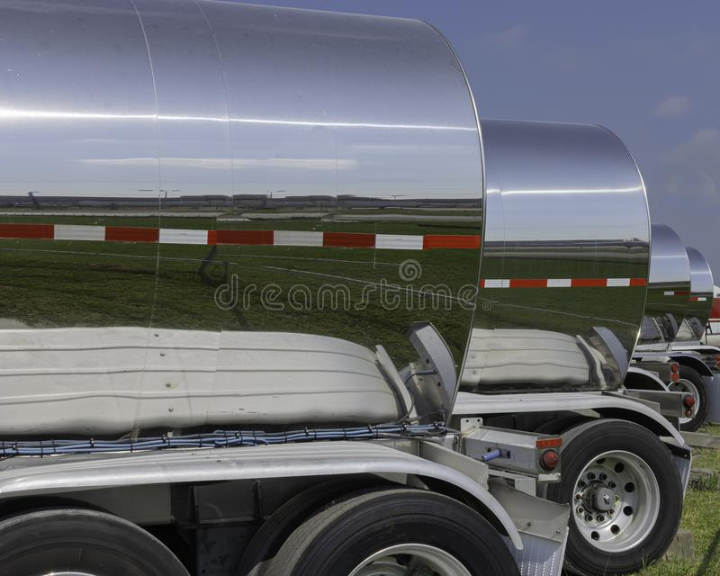 A Row of Stainless Steel Chemical Tank Wagons royalty free stock photography