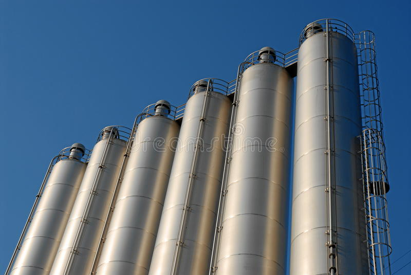 Row Of Steel Silos And Sky Royalty Free Stock Photos